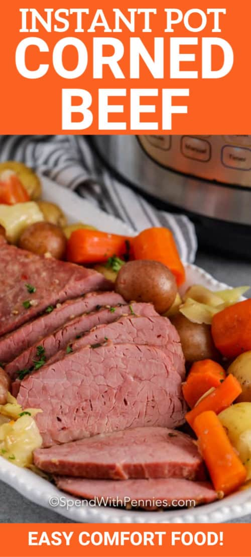 Instant Pot Corned Beef on a serving tray with vegetables.