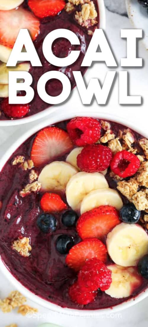 Acai bowl topped with bananas, berries, and granola.