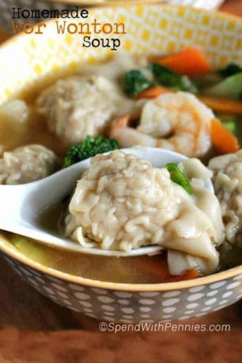 Homemade Wor Wonton Soup in a bowl with writing