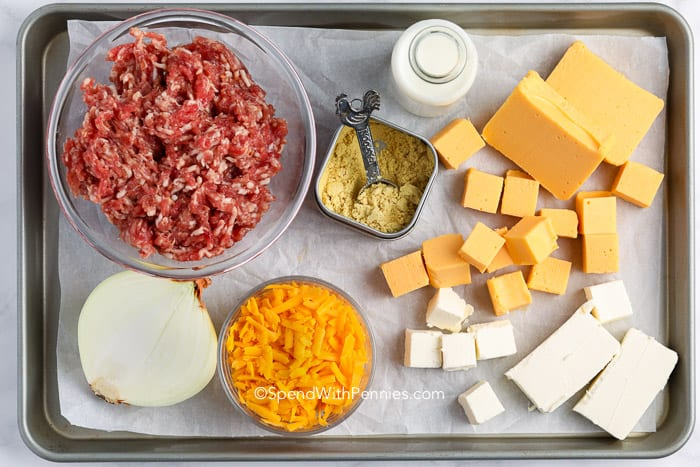 Ingredients for Sausage Cheese Dip on a baking sheet