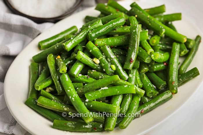 Seasoned Sauteed Green Beans on a white plate.