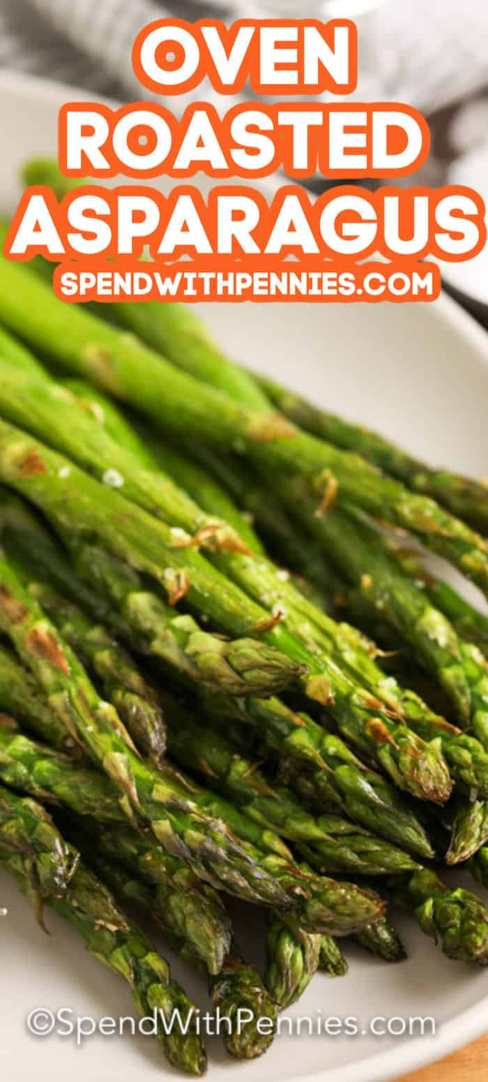 Oven roasted asparagus on a plate with text.
