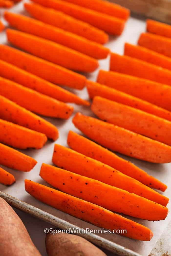 sliced sweet potato fries o na parchment lined baking sheet.
