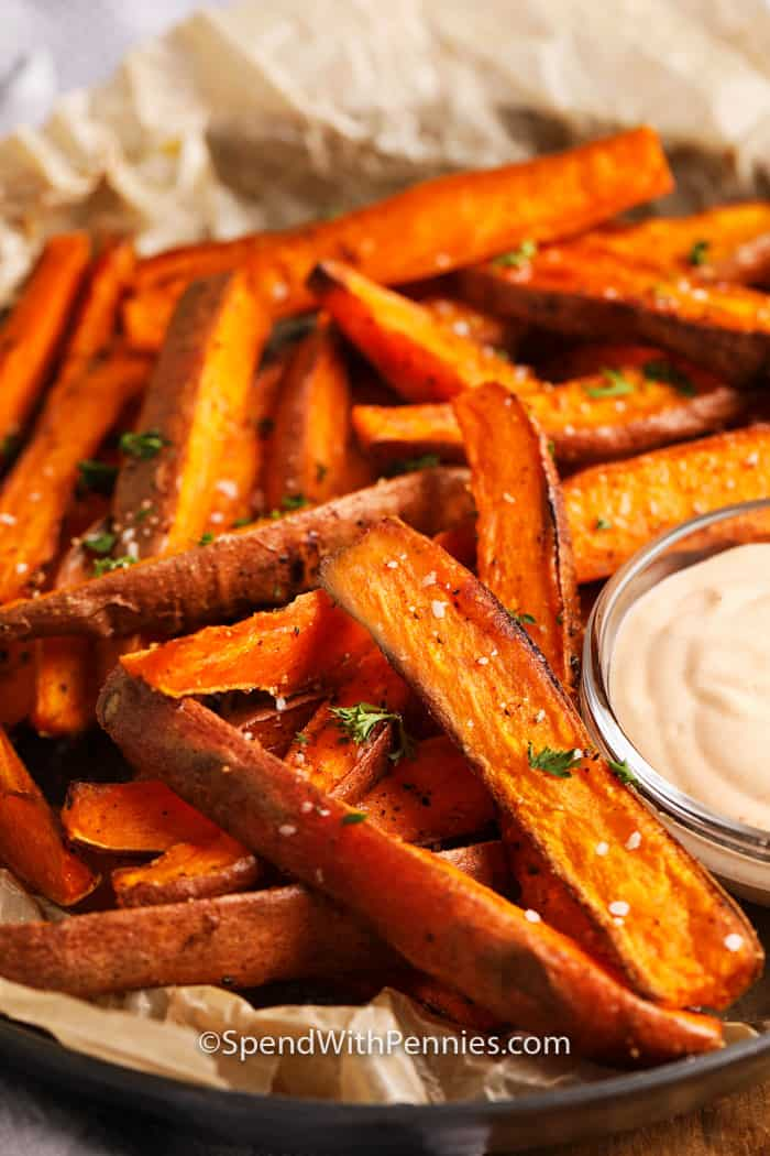 Sweet potato fries and aioli in a serving tray.