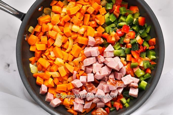 Overview of ingredients for Sweet Potato Hash in a pan.
