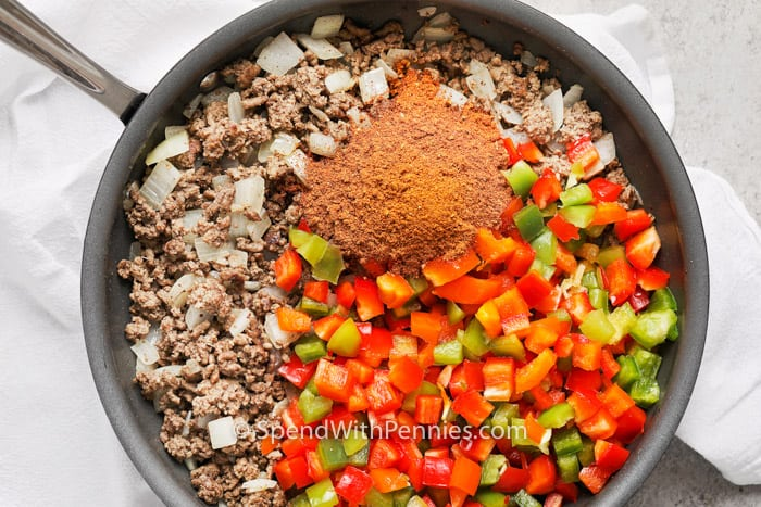 Taco Stuffed Pepper Casserole in a frying pan with ingredients