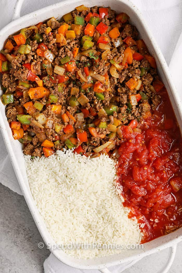 Taco Stuffed Pepper Casserole ingredients in a baking dish unmixed