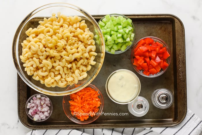 ingredients for macaroni salad on a tray