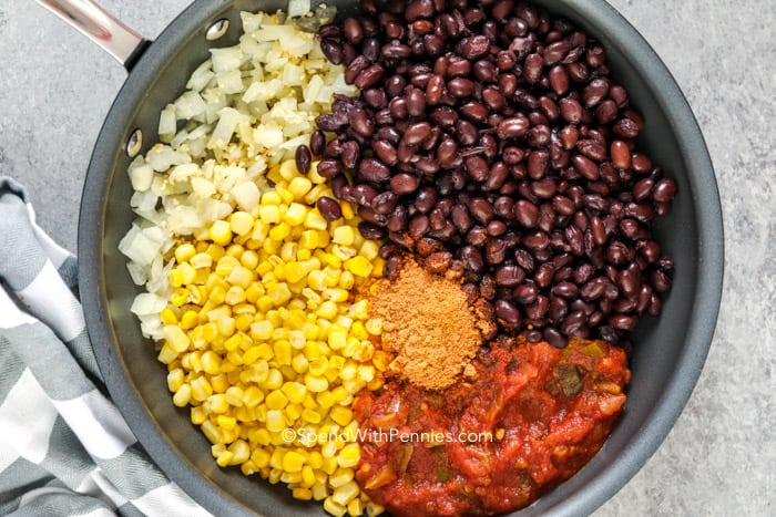 Black bean taco ingredients in a frying pan.