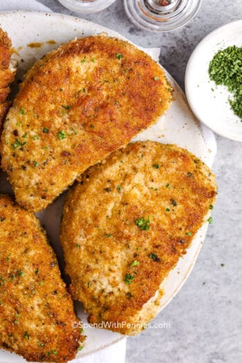 An overhead view of Baked Pork Chops on a plate with parsley