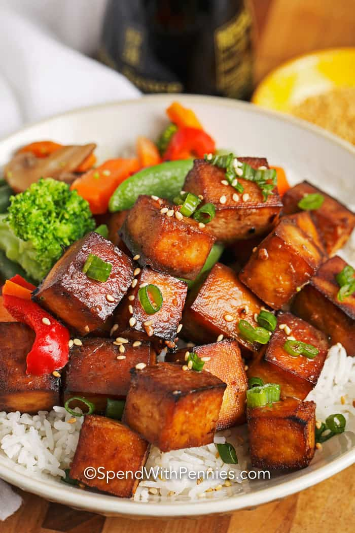 Baked tofu with veggies served over rice