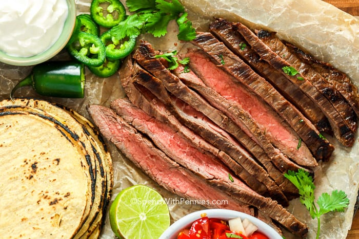 sliced Carne Asada with ingredients