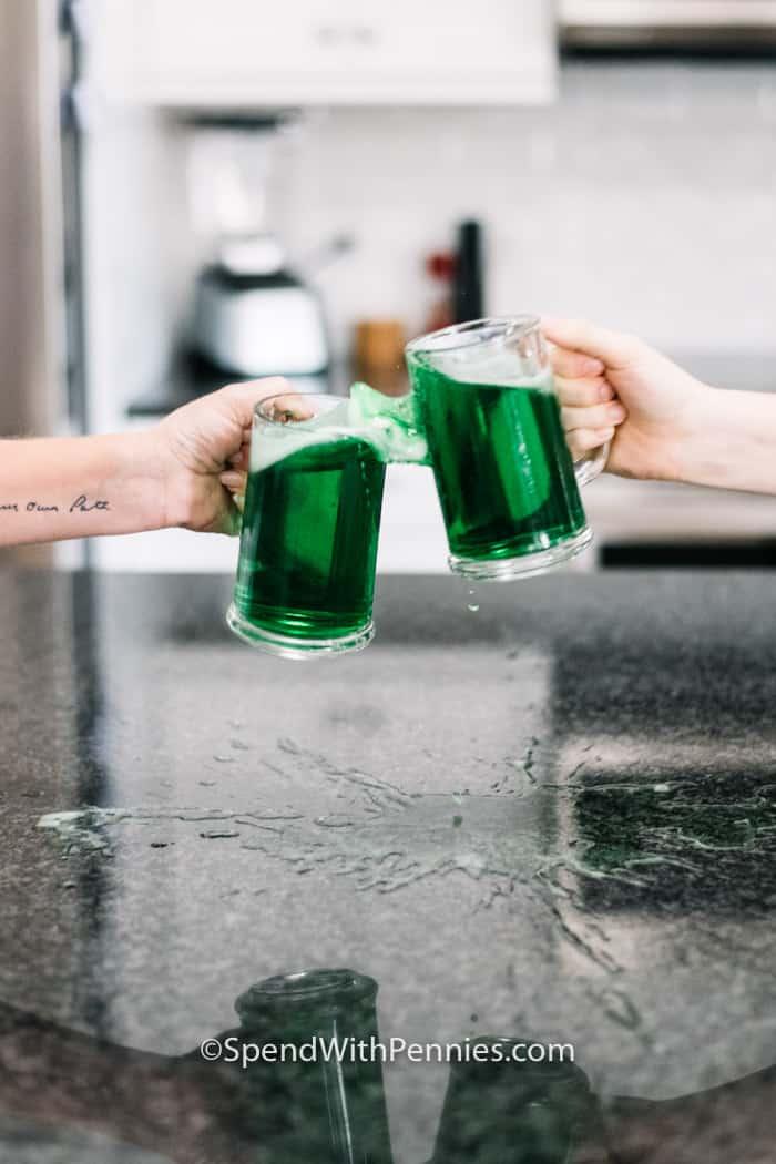 Two mugs of beer cheersing