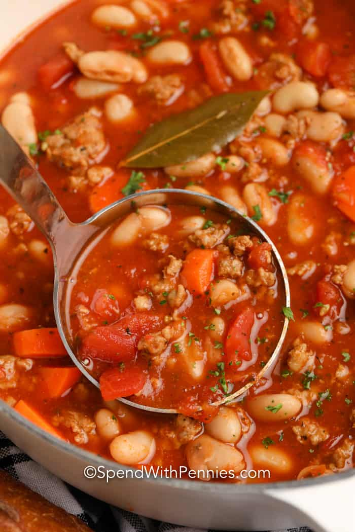 Italian Bean Soup in a pot being served