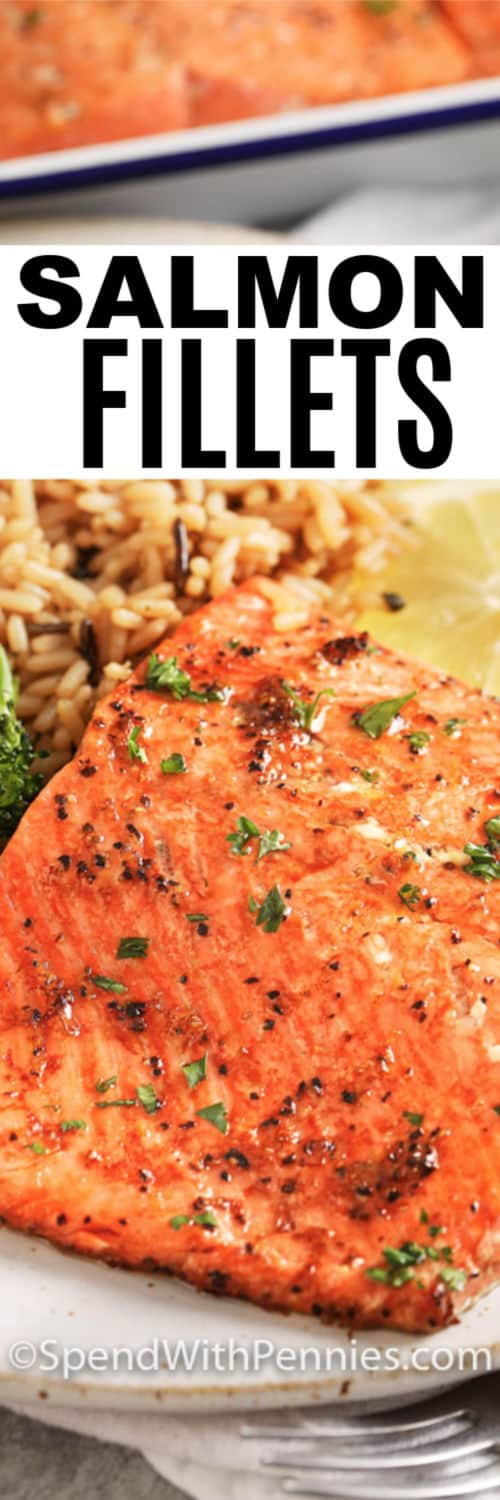 A close up of a broiled salmon fillet served with rice with text.