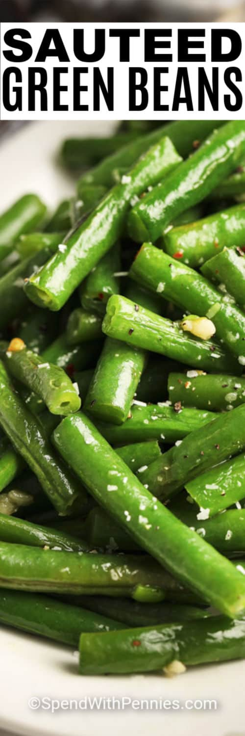 Close up of a bowl of sauteed green beans with writing