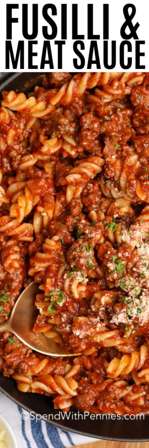 Fusilli with meat sauce in a frying pan with writing