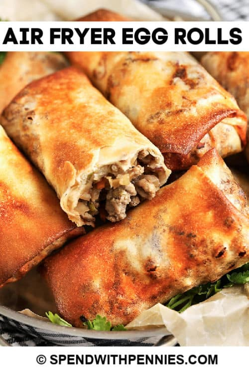 Air Fryer Egg Rolls in a basket with writing