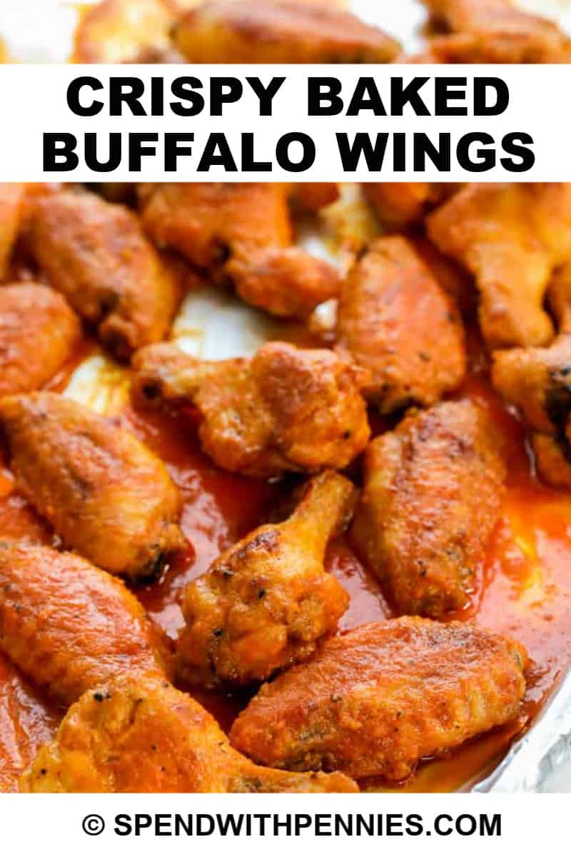 baked buffalo wings on a baking tray.
