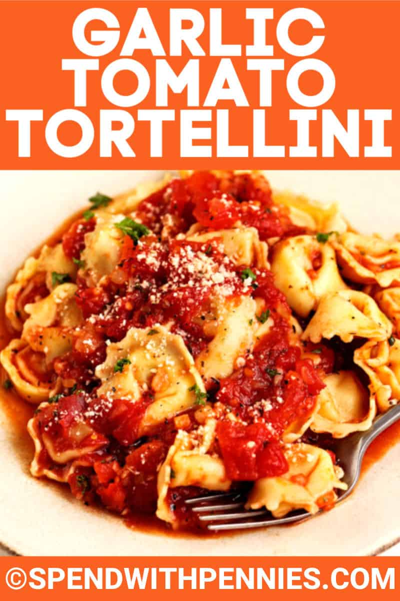 Garlic Tomato Tortellini in a plate and fork with writing