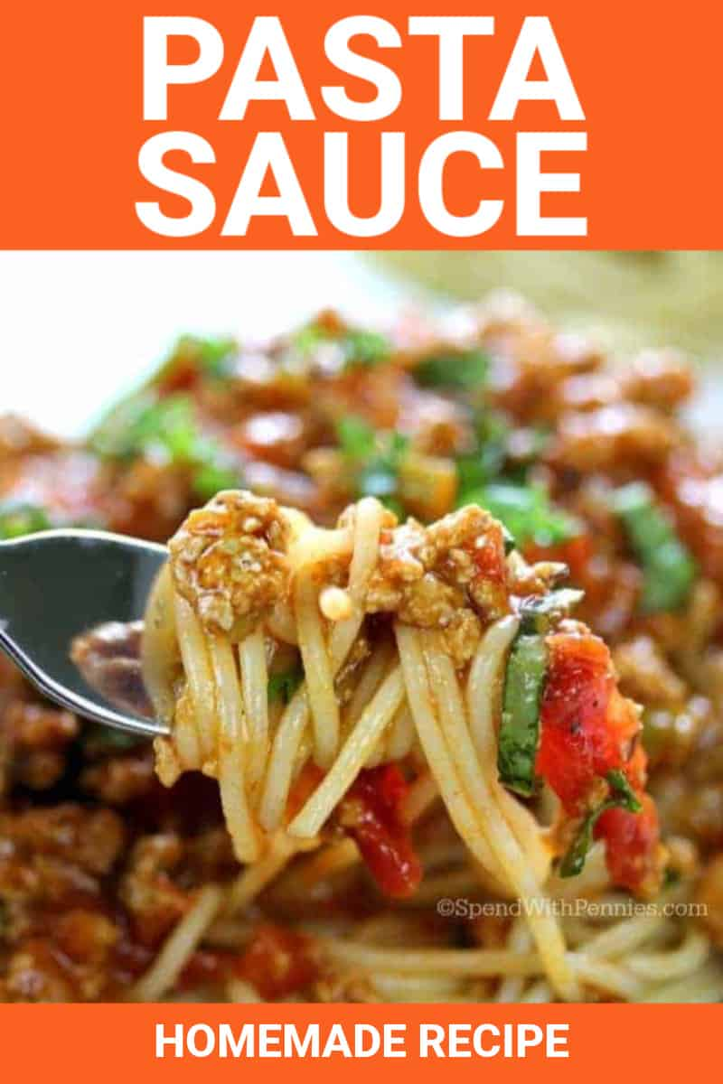 Pasta sauce and noodles on a fork with writing