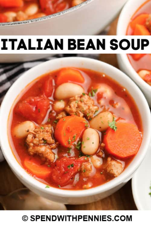 A bowl of Italian bean soup with writing