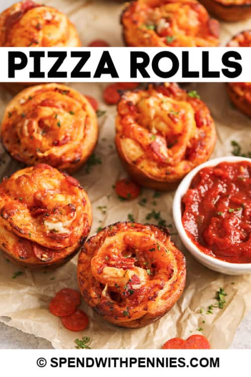 Pizza rolls with tomatoes sauce and writing