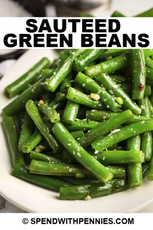 sauteed green beans in a bowl with writing.
