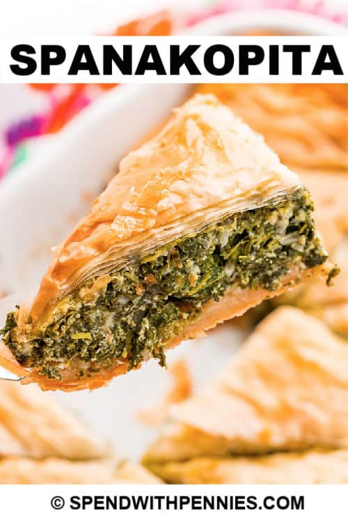 A slice of spanakopita with writing