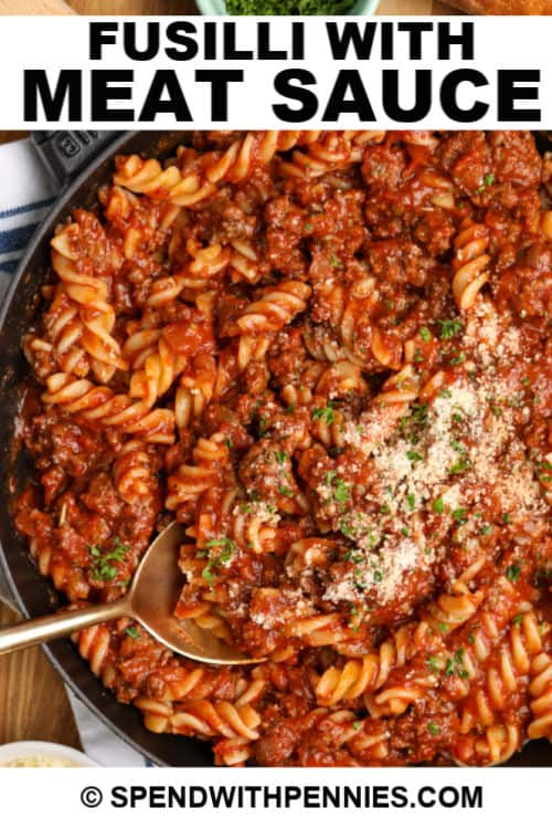 Fusilli and meat sauce with writing