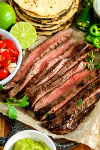 Carne Asada with ingredients around it