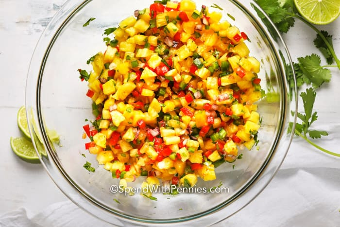 Pineapple salsa ingredients mixed in a glass bowl