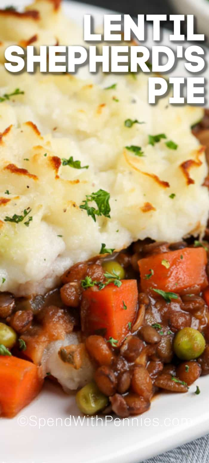 lentil shepherds pie on a plate with parsley and a title