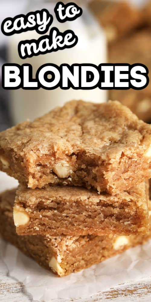 Blondies in a pile and the top one has a bite from it with writing