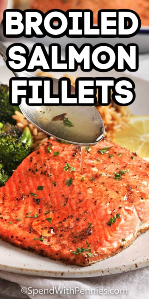 Broiled salmon fillet being sprinkles with juices with text.