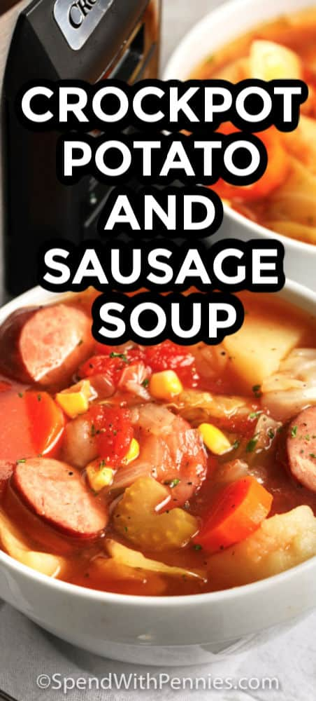 Close up of a serving of slow cooker potato and sausage soup with writing