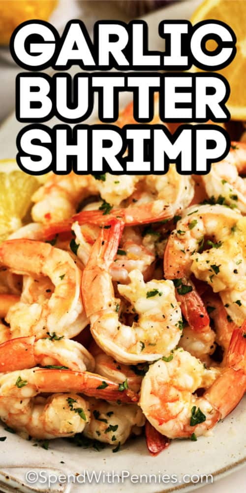 a plate of garlic butter shrimp with writing.