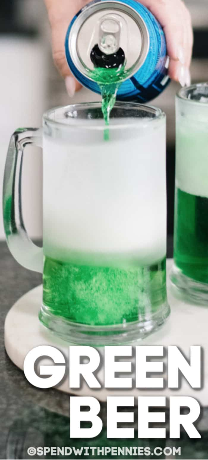 Mug of green beer with a can of regular beer being poured in with a title