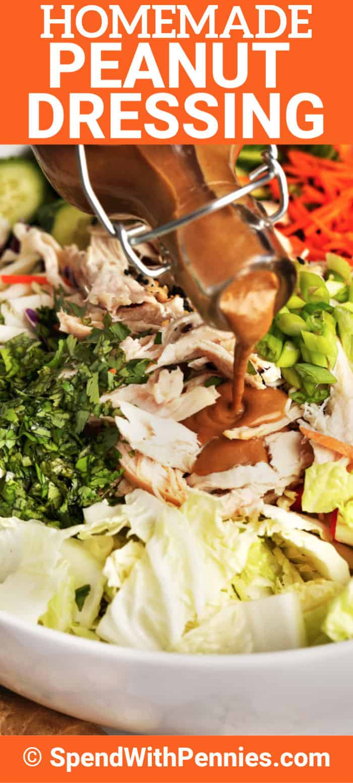 Peanut Dressing being poured over salad with writing