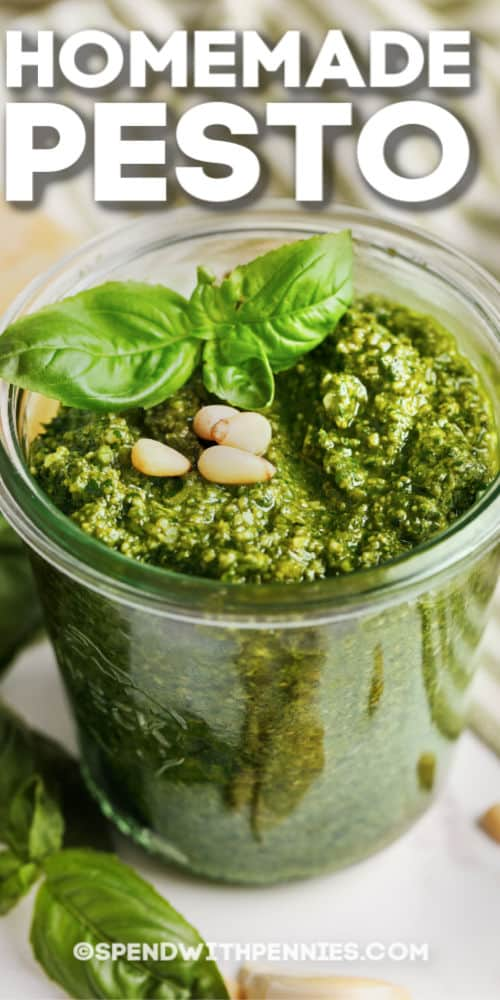 Homemade Pesto topped with basil and pine nuts with writing