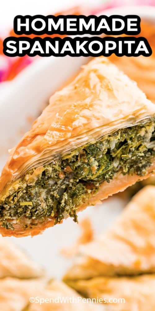 Close up of a slice of spanakopita with writing