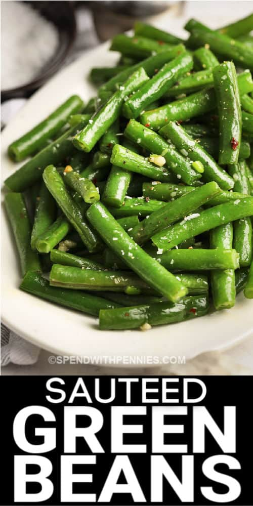 a serving bowl of sauteed green beans with writing