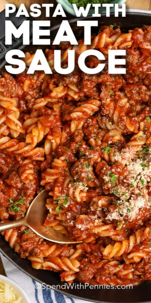 Fusilli with meat sauce garnished parsley with writing.