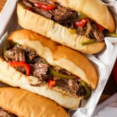 Three Slow Cooker Cheesesteaks in a tray