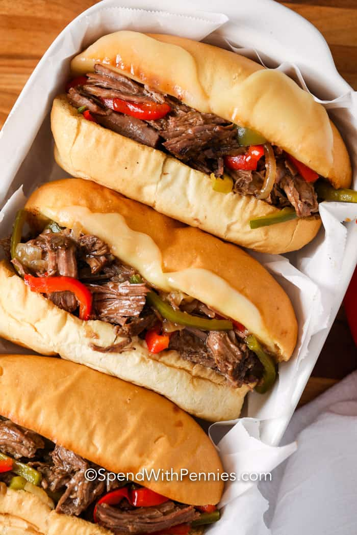 Three prepared Philly Cheesesteak Sandwiches.