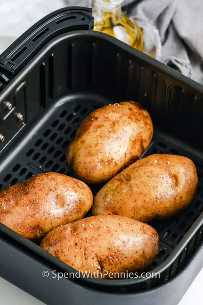 Air Fryer Baked Potatoes in an air fryer with seosoning before being cooked
