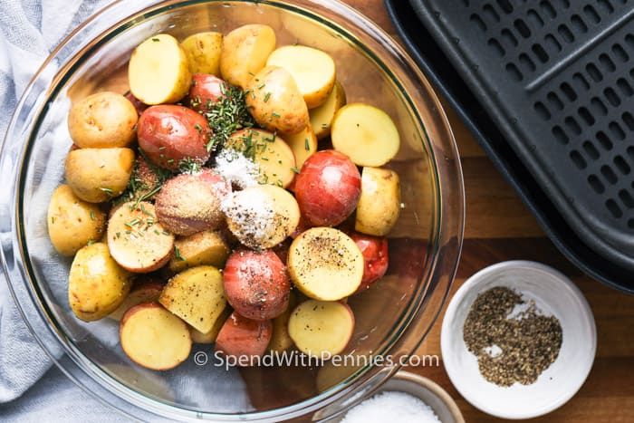 Air fryer potatoes ingredients in a bowl