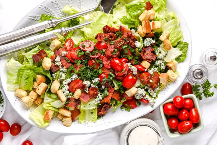 a fresh BLT salad with a creamy dressing and tomatoes