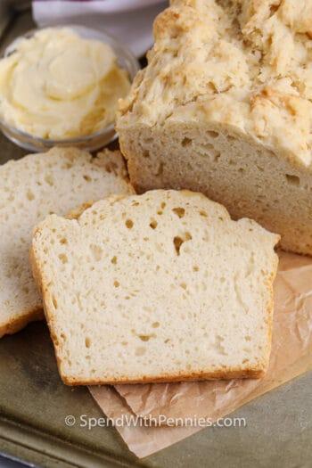 a slice of beer bread beside the loaf