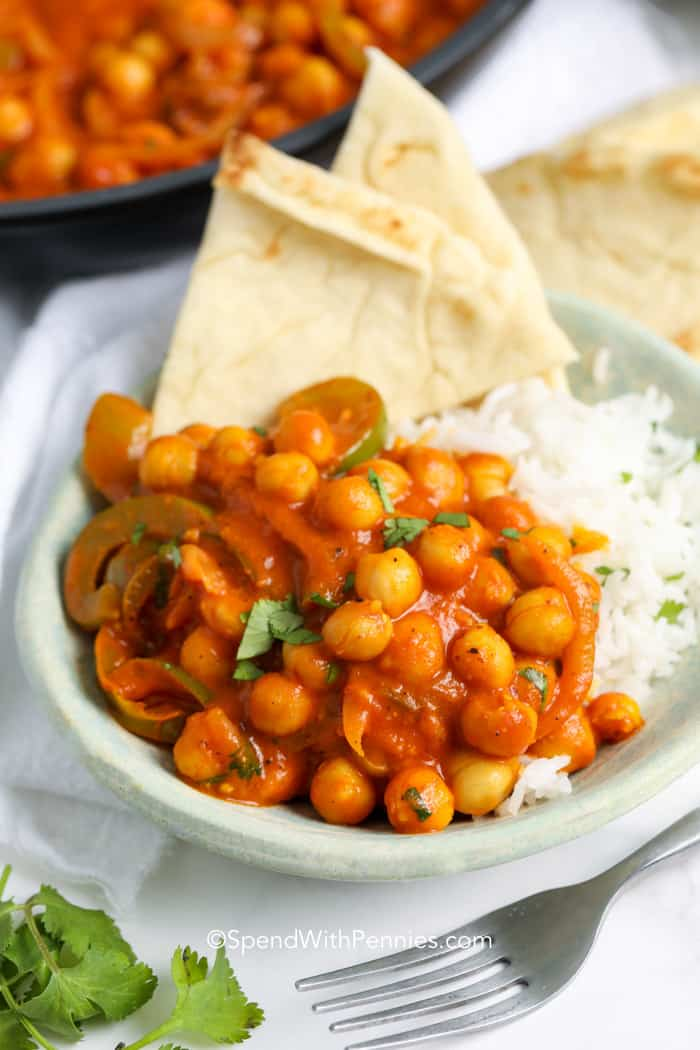 Curried Chickpeas served over a bowl of rice